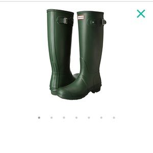 Dark green tall Hunter boots